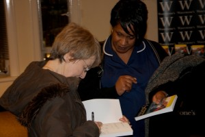 Signing a Copy of Migration Stories